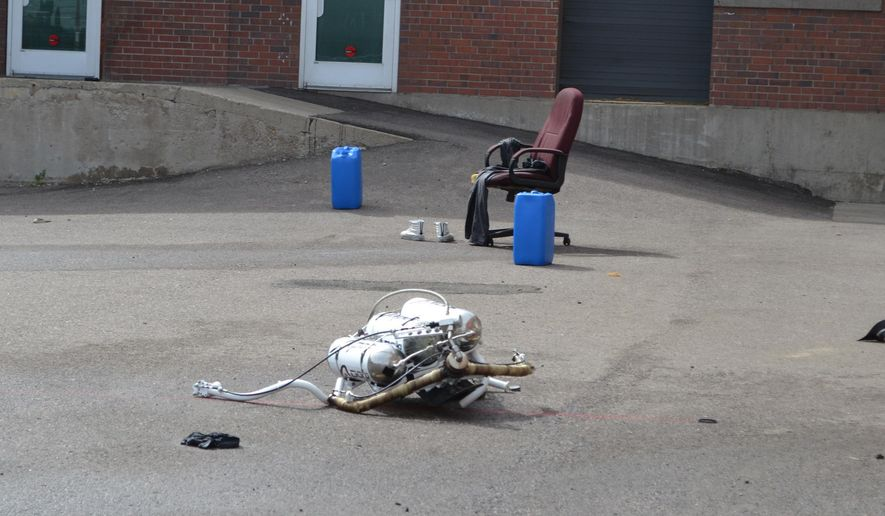 A jetpack lays at the site of a crash Friday, April 8, 2016, in Denver. The man who was wearing the pack, which was being demonstrated at a private business in the Mile High City, is in stable condition after the accident. (AP Photo/P. Solomon Banda)