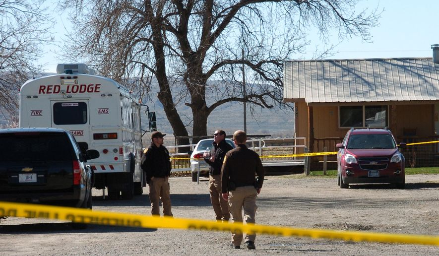 Law enforcement is seen at the scene of a triple slaying in the small town of Belfry, Mont. on Friday, April 8, 2016. A man accused of killing three people he was living with in a tiny Montana town was arrested early Friday after authorities tracked him to Washington state. Robert James LeCou faces three counts of deliberate homicide in the shooting deaths of two women and one man, whose bodies were discovered in a home in the tight-knit town of Belfry. (AP Photo/Matthew Brown)