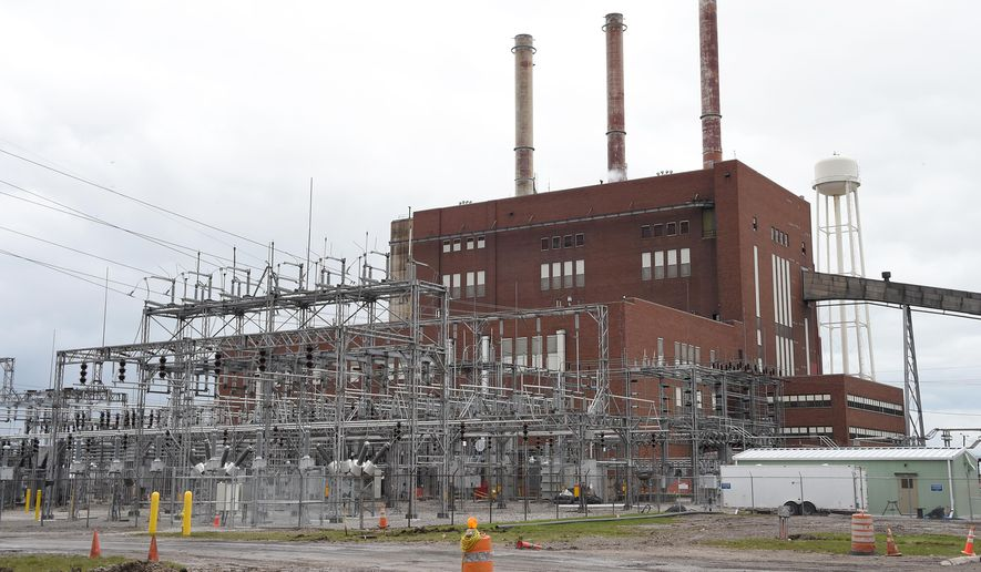 This photo taken April 7, 2016, shows the extorior of Consumers Energy's J.R. Whiting Generating Plant in Luna Pier, Mich. The coal-fired power plant in southeastern Michigan has been operating for 64 years, is closing on Friday, April 15, 2016. The plant produced enough power for about 300,000 households. (Tom Hawley/The Monroe News via AP) MANDATORY CREDIT