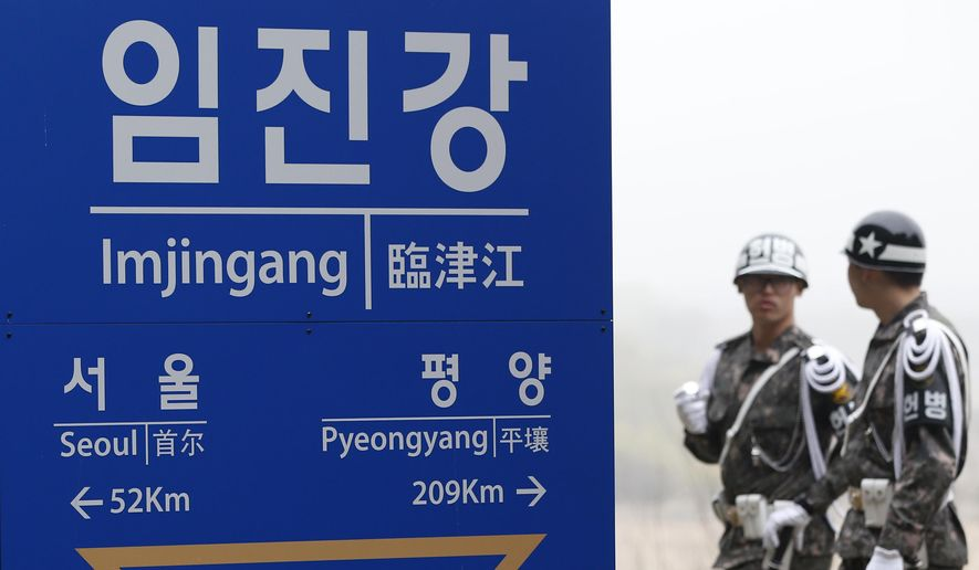 South Korean soldiers walk by a signboard showing the distance to the North Korea's capital Pyongyang and to South Korea's capital Seoul from Imjingang Station near the border village of the Panmunjom in Paju, South Korea, Saturday, April 9, 2016. (AP Photo/Lee Jin-man) ** FILE **