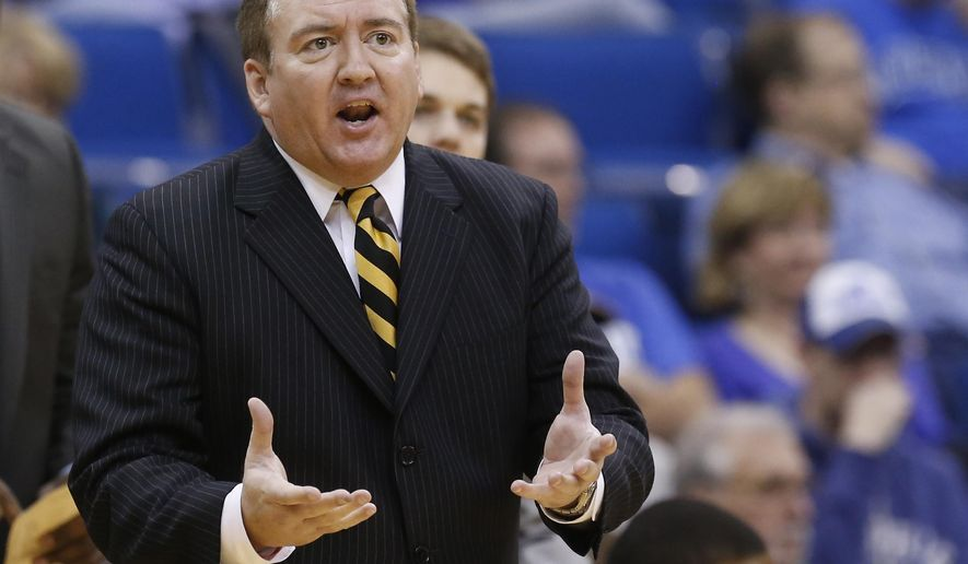 FILE - In this March 16, 2013, file photo, then-Southern Miss head coach Donnie Tyndall gestures during the championship game in the Conference USA men's NCAA college basketball tournament in Tulsa, Okla  Former Southern Mississippi basketball coach Donnie Tyndall has been hit with a 10-year show cause by the NCAA for his role in rules violations that occurred at the school during his tenure. The NCAA released its ruling in the case on Friday, April 8, 2016. (AP Photo/Sue Ogrocki, File)