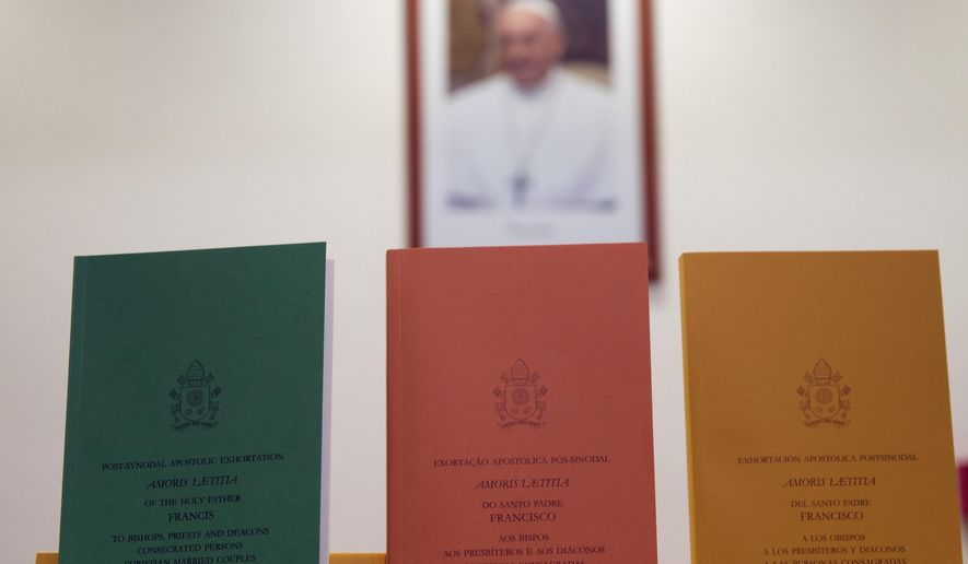 "Copies of the post-synodal apostolic exhortation ' Amoris Laetitia ' (The Joy of Love) document are on display prior to the start of a press conference, at the Vatican, Friday, April 8, 2016. Pope Francis has insisted that individual conscience be the guiding principle for Catholics negotiating the complexities of sex, marriage and family life in a major document released Friday that repudiates the centrality of black and white rules for the faithful. In the 256-page document ""The Joy of Love,"" released Friday, Francis makes no change in church doctrine. (AP Photo/Andrew Medichini)"