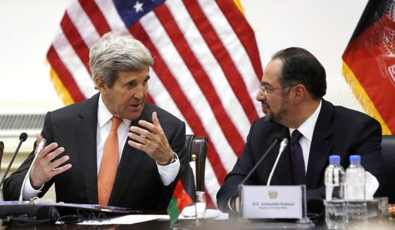 U.S. Secretary of State John Kerry, left, and Afghanistan's Foreign Minister Salahuddin Rabbani talk at the start of their bilateral commission talks at Char Chinar Palace in Kabul, Afghanistan, Saturday, April 9, 2016. (Jonathan Ernst/Pool via AP)