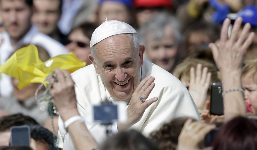 Pope Francis smiles as he blesses faithful as he arrives in St. Peter's Square to attend a jubilee audience at the Vatican, Saturday, April 9, 2016. (AP Photo/Gregorio Borgia)