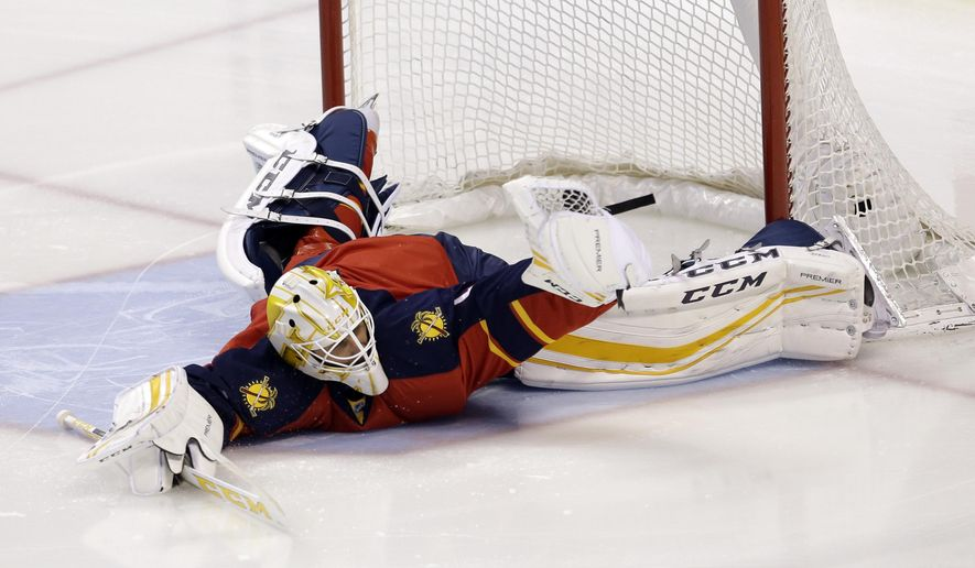 Florida Panthers goalie Roberto Luongo (1) stops a shot by the Carolina Hurricanes during the first period of an NHL hockey game, Saturday, April 9, 2016, in Sunrise, Fla. (AP Photo/Alan Diaz)