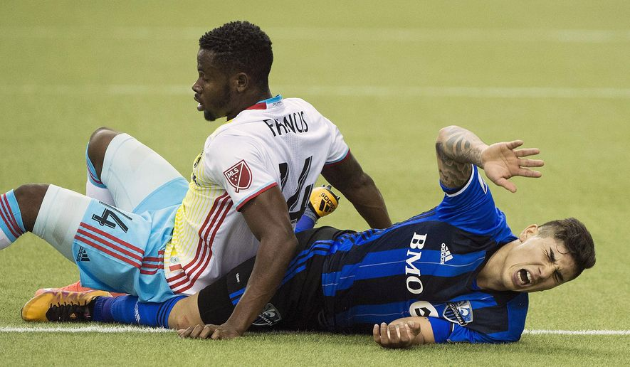 Montreal Impact's Lucas Ontivero, right, challenges Columbus Crew SC's Waylon Francis during second-half MLS soccer game action in Montreal, Saturday, April 9, 2016. (Graham Hughes/The Canadian Press via AP) MANDATORY CREDIT