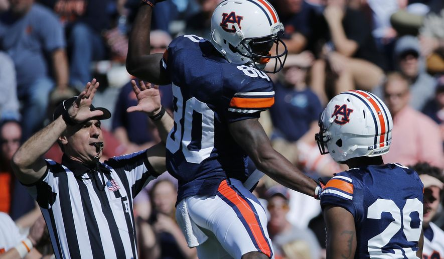 Auburn wide receiver Marcus Davis (80) celebrates with wide receiver Tyler Stovall, left, in the first half of a spring NCAA college football game Saturday, April 9, 2016, in Auburn, Ala. (AP Photo/Brynn Anderson)