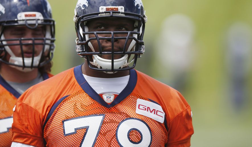 FILE - In this May 27, 2015, file photo, Denver Broncos offensive tackle Ryan Clady waits to take part in drills during an NFL football organized team activity at the team's headquarters in Englewood, Colo. A person familiar with the deal tells The Associated Press that the Broncos have agreed to trade left Clady to the New York Jets along with a seventh-round pick for a fifth-round selection in the upcoming NFL draft. The person spoke on condition of anonymity because the teams hadn't announced the trade, which was first reported by ESPN. (AP Photo/David Zalubowski, File)