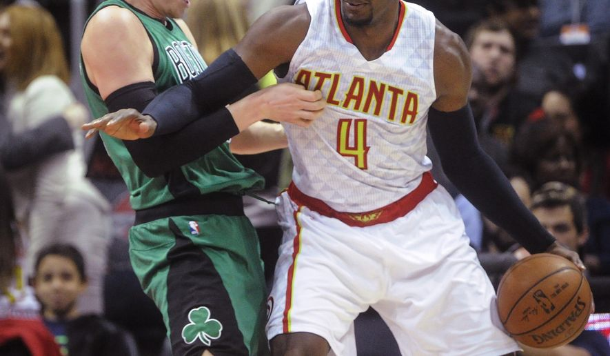 Atlanta Hawks forward Paul Millsap (4) keeps the ball from Boston Celtics forward Jonas Jerebko during the first half of an NBA basketball game Saturday, April 9, 2016, in Atlanta. (AP Photo/John Amis)