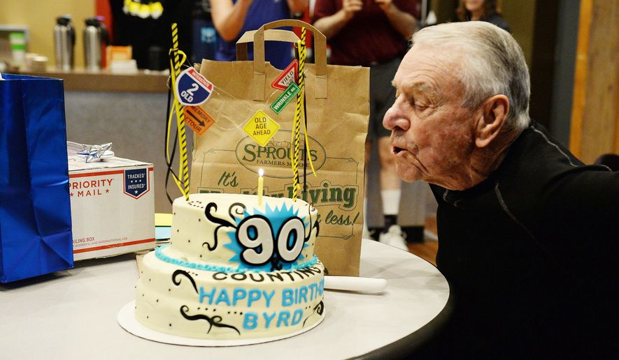 "ADVANCE FOR SATURDAY, APRIL 9 -In this Friday, Feb. 26, 2016, photograph, 90-year-old Byrd Curtis blows out the candle on his cake at his birthday party in Miramont North Lifestyle Fitness in Fort Collins, Colo. Curtis has been working out there for 15 years and has been dubbed ""Mayor of Miramont."" (Valerie Mosley/The Coloradoan via AP) MANDATORY CREDIT"