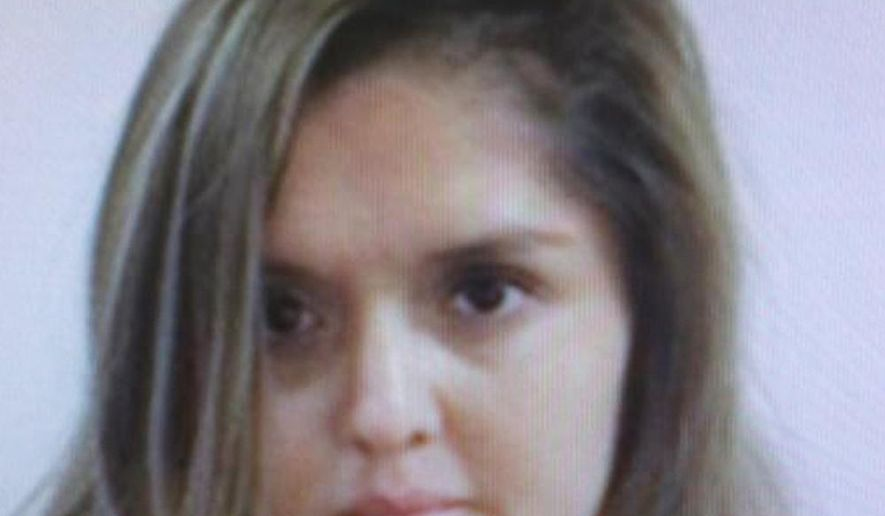 FILE - This undated handout file photo provided by the FBI shows Brenda Delgado. Mexican prosecutors on Friday, April 8, 2016, said they have detained, Delgado, a woman on the FBI's 10 Most Wanted fugitives list for the killing of a dentist in Texas. Delgado was detained at a house in the city of Torreon, in northern Coahuila state, according to the Attorney General's Office. (FBI via AP, File)