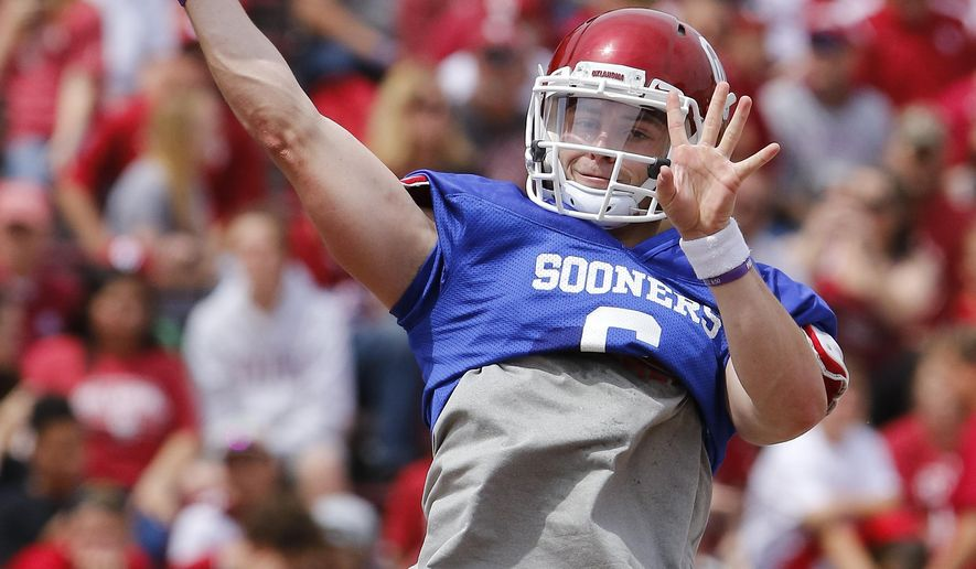 Oklahoma quarterback Baker Mayfield throws a pass during a spring NCAA college football game in Norman, Okla., Saturday, April 9, 2016. (AP Photo/Alonzo Adams)