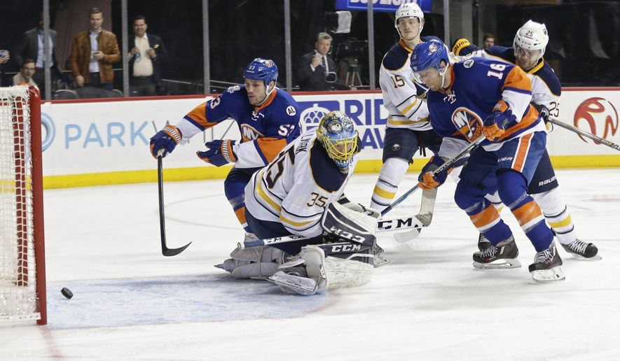 Buffalo Sabres goalie Linus Ullmark (35), New York Islanders Casey Cizikas (53) and Steve Bernier (16) watch as the puck shot by Scott Mayfield gets past Ullmark for a goal during the second period of an NHL hockey game Saturday, April 9, 2016, in New York. (AP Photo/Frank Franklin II)