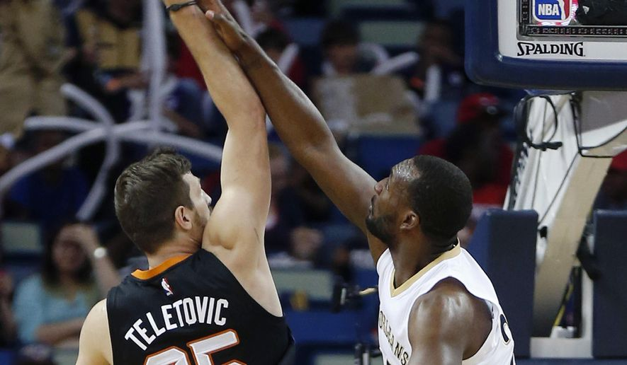 Phoenix Suns forward Mirza Teletovic (35) shoots against New Orleans Pelicans guard Jordan Hamilton (25) in the first half of an NBA basketball game in New Orleans, Saturday, April 9, 2016. (AP Photo/Gerald Herbert)