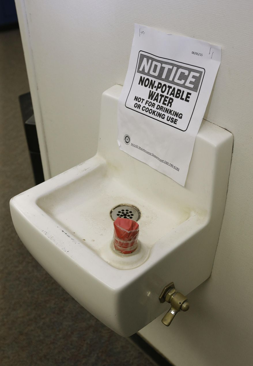 In this photo taken Wednesday, April 6, 2016, tape covers the spout and a sign warns students not to use this water fountain at Foothill Intermediate School in Loma Rica, Calif.  Many public water systems in California serving schools, parks, prisons and neighborhoods have found lead at levels unsafe for drinking. Dozens of water systems in the state reported they detected lead in the past three years that exceeded federal standards for human consumption.  (AP Photo/Rich Pedroncelli)