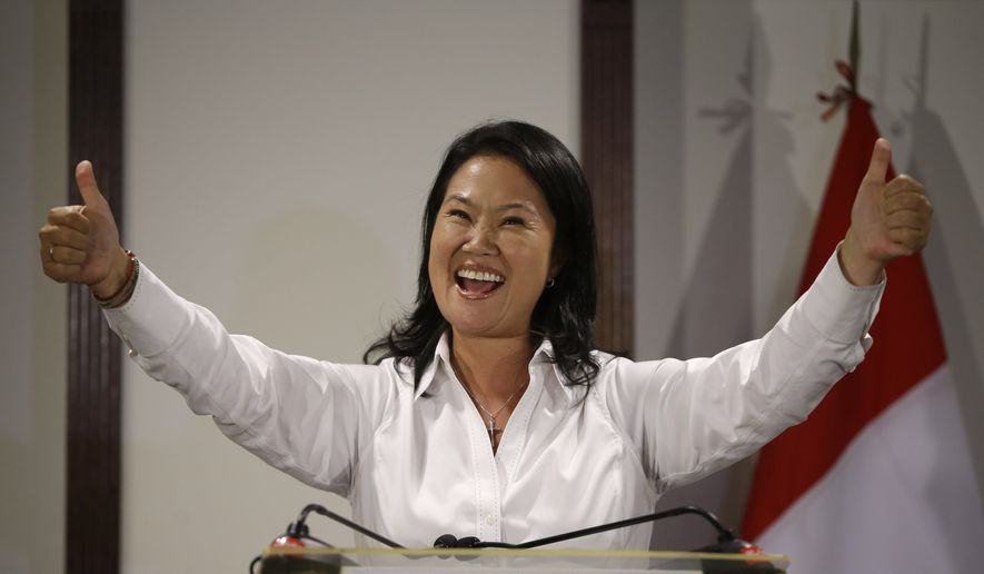Presidential candidate Keiko Fujimori, daughter of jailed former President Alberto Fujimori, gives the thumbs up during a news conference, in Lima, Peru, Sunday, April 10, 2016. (AP Photo/Martin Mejia)