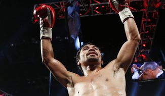 Manny Pacquiao, of the Philippines, celebrates after defeating Timothy Bradley in their WBO welterweight title boxing bout Saturday, April 9, 2016, in Las Vegas. (AP Photo/John Locher)