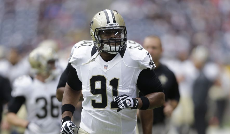 New Orleans Saints' Will Smith (91) warms up with teammates before a preseason NFL football game Sunday, Aug. 25, 2013, in Houston. (AP Photo/Eric Gay)