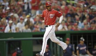Washington Nationals' Ben Revere comes in to score during the third inning of an interleague exhibition baseball game against the Minnesota Twins, Friday, April 1, 2016, in Washington. The Nationals won 4-3. (AP Photo/Nick Wass)