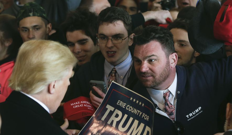 Supporters of Republican presidential candidate Donald Trump get autographs after a rally at JetSmart Aviation Services on Sunday, April 10, 2016, in Rochester, N.Y. (AP Photo/Mike Groll)
