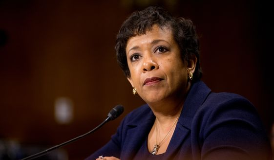 "Attorney General Loretta Lynch told the Senate Judiciary Committee that her department has discussed pursuing civil charges against the ""climate denial scheme,"" as Sen. Sheldon Whitehouse, Rhode Island Democrat, put it. (Associated Press)"
