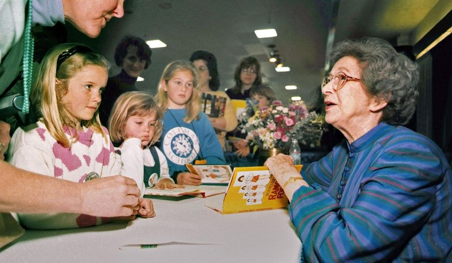 In this April 19, 1998 photo, Beverly Cleary signs books at the Monterey Bay Book Festival in Monterey, Calif. Even as she turns 100, the feisty and witty author, Cleary remembers the Oregon childhood that inspired the likes of characters Ramona and Beezus Quimby and Henry Huggins in the children's books that sold millions and enthralled generations of youngsters. (Vern Fisher/Monterey Herald via AP)
