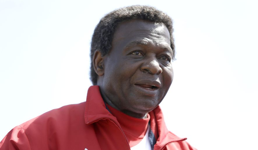 FILE - In this March 10, 2013, file photo, Former St. Louis Cardinals great Lou Brock attends an exhibition spring training baseball game between the  Cardinals and the New York Mets in Jupiter, Fla. Brock, whose left leg was amputated just below the knee in the offseason, will throw out the ceremonial first pitch before a sold-out game against the Milwaukee Brewers, Monday, April 11, 2016. (AP Photo/Jeff Roberson, File)