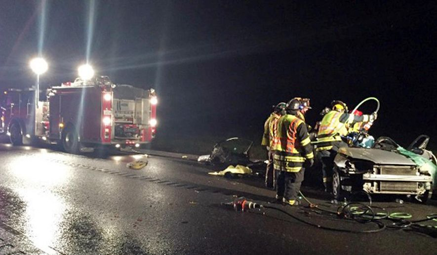 In this April 9, 2016 photo provided by KCRA-TV, firefighters view the wreckage of a Honda Civic that slammed into a Chevrolet Silverado pickup truck, killing all five occupants, on a two-lane highway in Rio Vista, Calif., about 40 miles southwest of Sacramento. (Tom Miller/KCRA-TV via AP) MANDATORY CREDIT; TV OUT