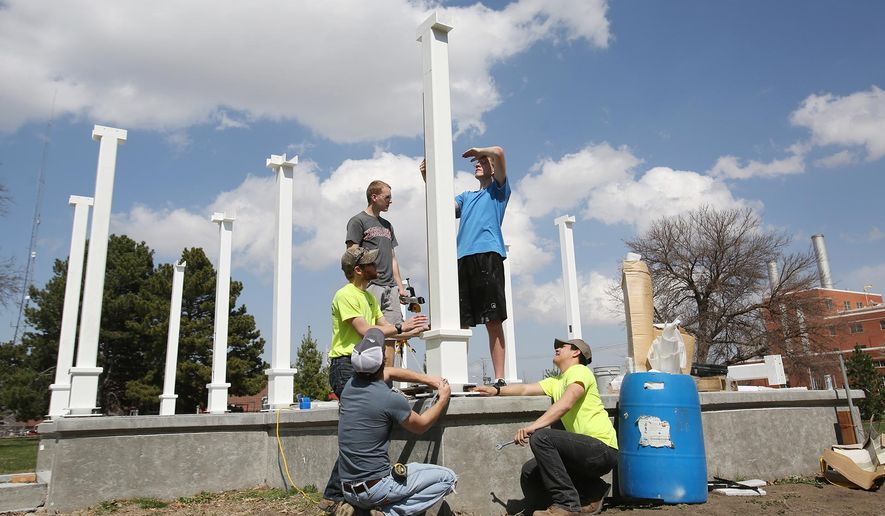 Central Community College-Hastings construction technology students, clockwise from top, Jeff Barnes, Allen Garcia, Kamron Dawe, Sam Thompson and Bryon Mondt level pillars at Highland Park Arboretum on March 30, 2016 in Hastings, Neb. Fundraising began five years ago with a $25,000 donation from Five Points Bank of Hastings. But, since then, there have been snags in the construction schedule. In the meantime, hundreds of other donations came in, including funding from the Hastings Community Foundation and Adams County Convention and Visitors Bureau. (Laura Beahm/The Hastings Tribune via AP) MANDATORY CREDIT