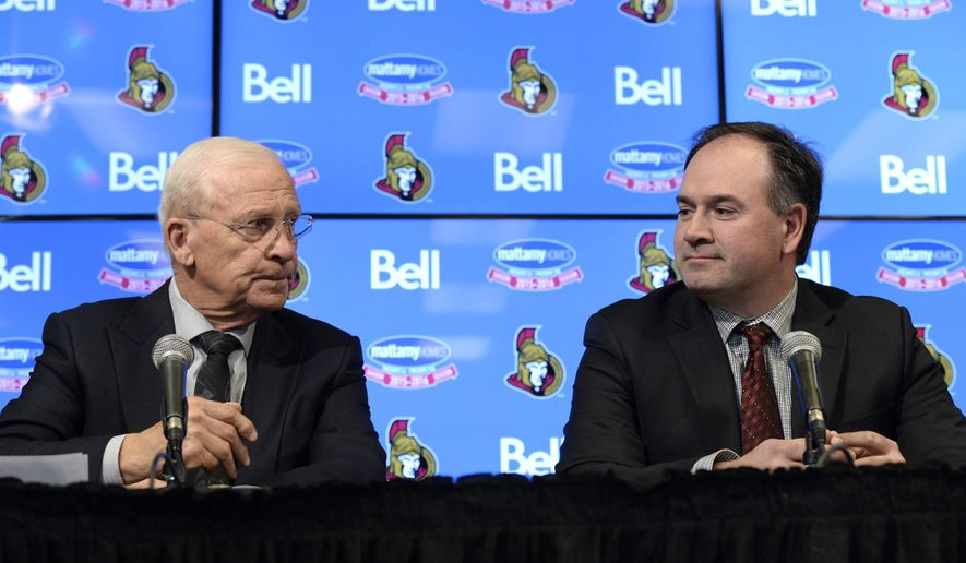 Ottawa Senators' Bryan Murray, left, and incoming general manager Pierre Dorion, look on during a press conference announcing that Murray is stepping down as general manager, Sunday April 10, 2016, in Ottawa. (Justin Tang/The Canadian Press via AP)