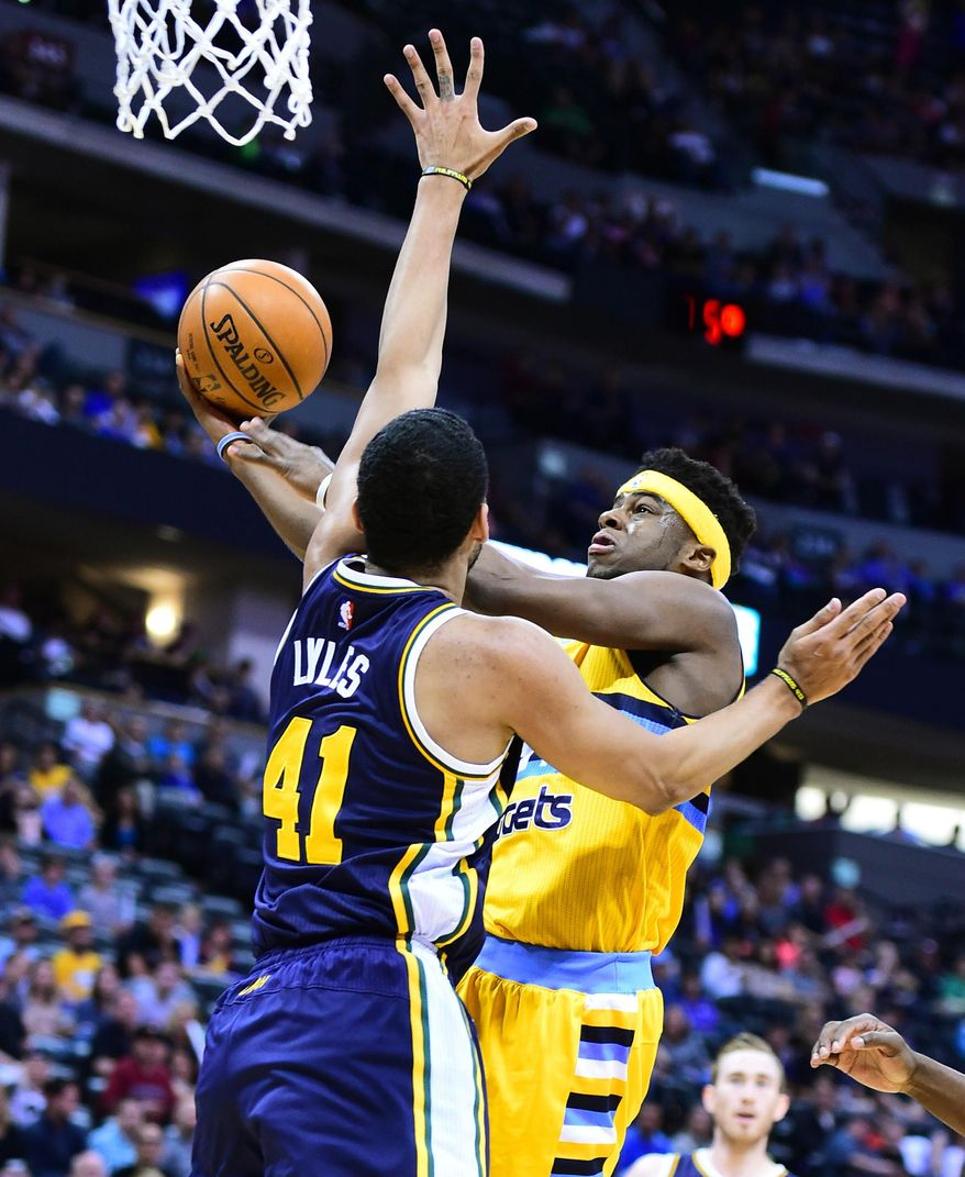 Utah Jazz forward, Trey Lyles, tries to stop Emmanuel Mudiay, of the Denver Nuggets, in the first half of an NBA basketball game in Denver on Sunday, April 10, 2016. (Cliff Grassmick/Daily Camera via AP) MANDATORY CREDIT