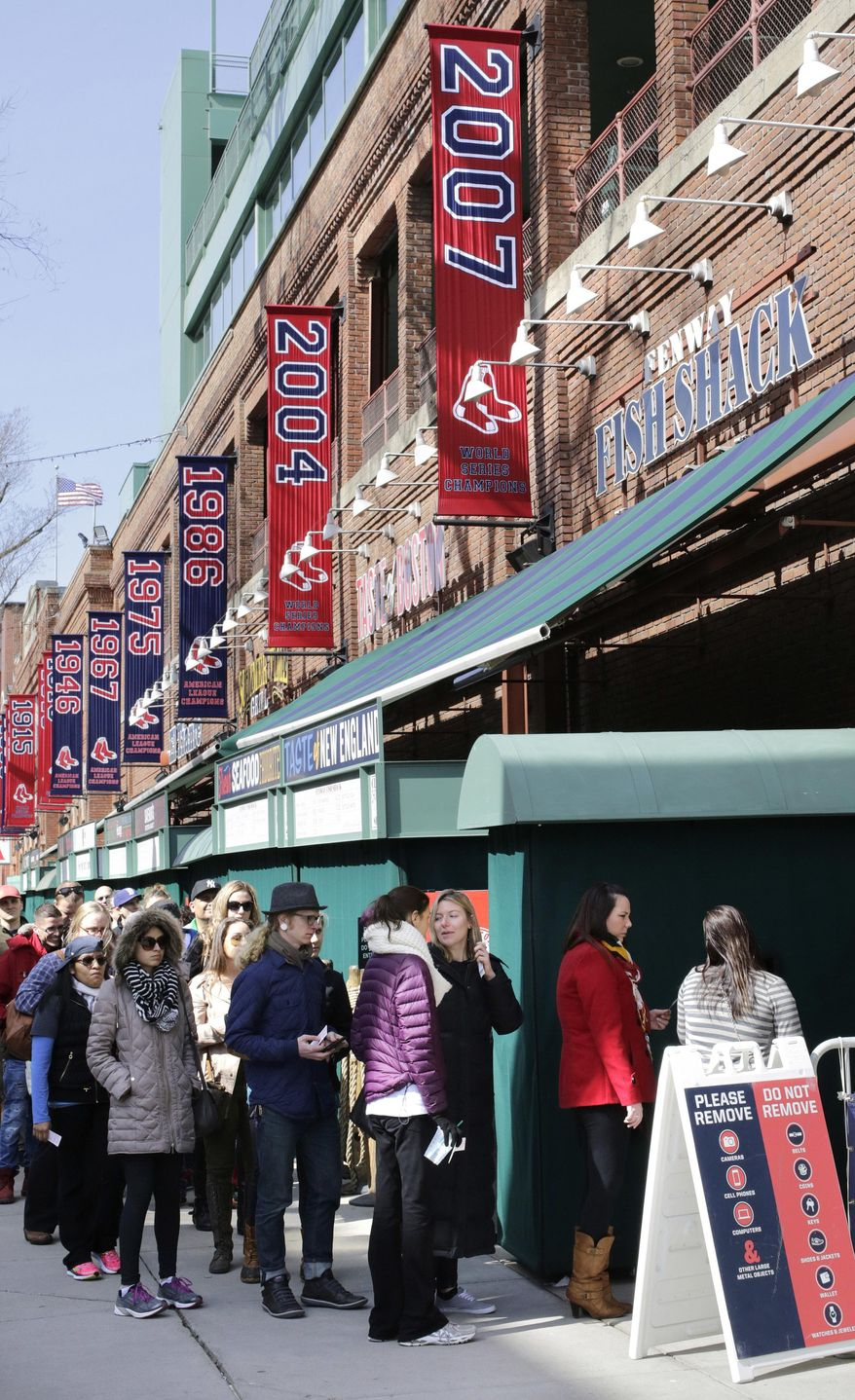 People form a line outside Fenway Park while waiting for a guided tour of the baseball park, Sunday, April 10, 2016, in Boston. The Red Sox are to play the Baltimore Orioles, Monday at Fenway in their home-opener. (AP Photo/Steven Senne)