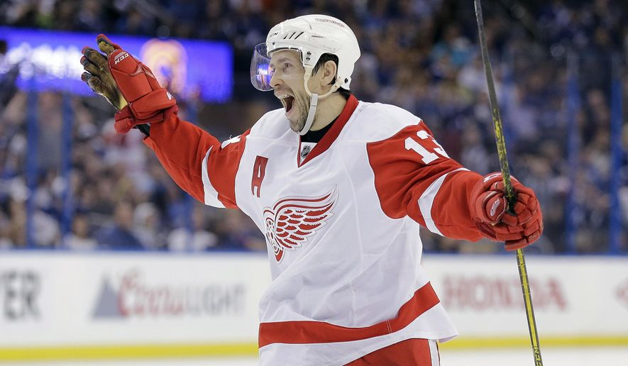 FILE - In this April 25, 2015, file photo, Detroit Red Wings center Pavel Datsyuk, of Russia, celebrates his goal against the Tampa Bay Lightning during the third period of Game 5 of a first-round NHL Stanley Cup hockey playoff series in Tampa, Fla. Datsyuk is expected to retire from the NHL after the playoffs. Datsyuk discussed his plans for the first time in an interview with the Detroit Free Press published Sunday, April 10, 2016. (AP Photo/Chris O'Meara, File)
