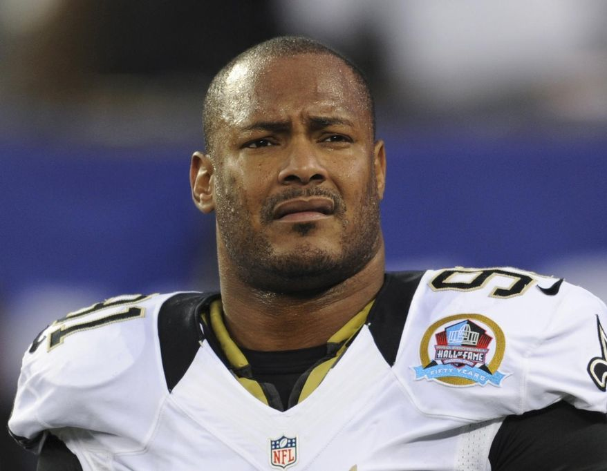 FILE - In this Dec. 9, 2012, file photo, New Orleans Saints defensive end Will Smith appears before an NFL football game against the New York Giants in East Rutherford, N.J. Smith was fatally shot after a traffic accident in New Orleans. (AP Photo/Bill Kostroun, File)