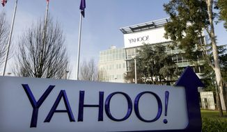 This Jan. 14, 2015, file photo shows a sign outside Yahoo's headquarters in Sunnyvale, Calif. (AP Photo/Marcio Jose Sanchez, File)