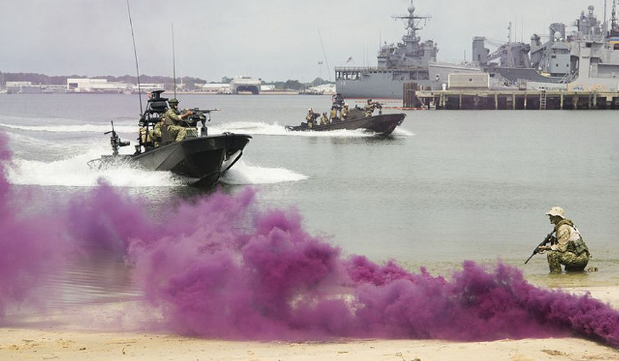 Members of SEAL Team 18 perform a demonstration. (U.S. Navy photo)