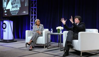 "Rachel Robinson, left, and filmmaker Ken Burns participate in the ""Jackie Robinson"" panel at the PBS Winter TCA on Monday, Jan.18, 2016, in Pasadena, Calif. (Photo by Richard Shotwell/Invision/AP)"