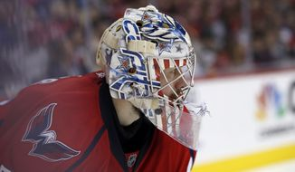 Washington Capitals goalie Philipp Grubauer (31), from Germany, pauses in the second period of an NHL hockey game against the Anaheim Ducks, Sunday, April 10, 2016, in Washington. (AP Photo/Alex Brandon)