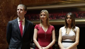 Donald Trump's children Eric Trump, and Ivanka Trump, center, and Donald Trump's wife Melania Trump, attend a news conference, in New York, Thursday, May 1, 2014. (AP Photo/Richard Drew)