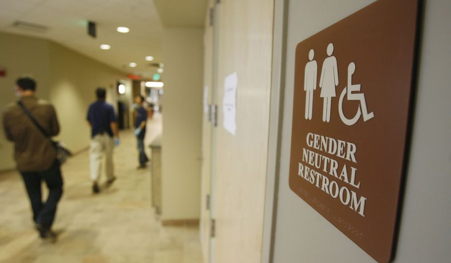 A sign marks the entrance to a gender neutral restroom at the University of Vermont in Burlington, Vt. (Associated Press) ** FILE **