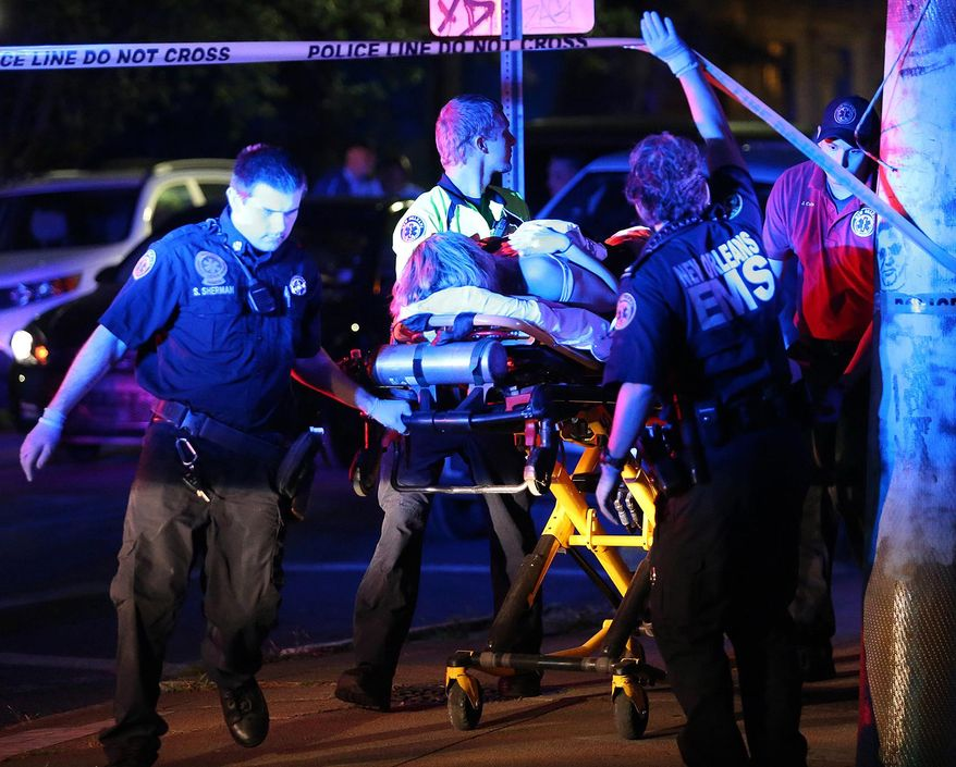 Paramedics with New Orleans EMS transport Racquel Smith, wife of former New Orleans Saints' Will Smith, following a shooting in New Orleans late Saturday, April 9, 2016. The former New Orleans Saints player was fatally shot after a traffic accident. (Michael DeMocker/NOLA.com The Times-Picayune via AP) MAGS OUT; NO SALES; USA TODAY OUT; THE BATON ROUGE ADVOCATE OUT; THE NEW ORLEANS ADVOCATE OUT; MANDATORY CREDIT