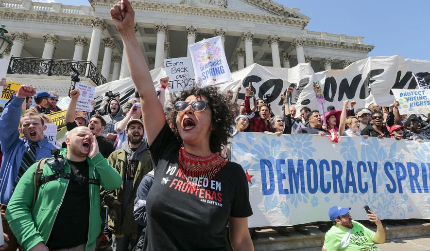 Alejandra Pablos of Arizona leads a chant as voting rights reform demonstrators stage a sit-in at the Capitol in Washington, Monday, April 11, 2016, urging lawmakers to take money out of the political process.  (AP Photo/J. Scott Applewhite)