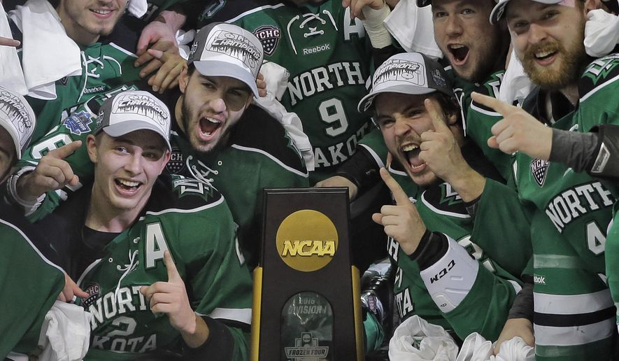 North Dakota players celebrate their 5-1 win over Quinnipiac during an NCAA Frozen Four championship college hockey game Saturday, April 9, 2016, in Tampa, Fla. (AP Photo/Chris O'Meara)