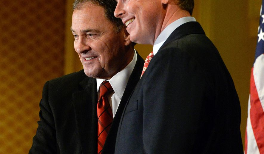 Republican candidates for Utah governor, current governor Gary Herbert, left, and Jonathan Johnson, pose for photographs following the first fledged debate at the Little America Hotel in Salt Lake City on Monday, April 11, 2016. (Francisco Kjolseth/The Salt Lake Tribune via AP)