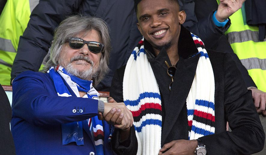 FILE -- In this photo taken on Jan. 25, 2015 in Genoa, Samuel Eto'o, right, poses with Sampdoria President Massimo Ferrero as they sit in the stands prior to a Serie A soccer match between Sampdoria and Palermo. Four-time African player of the year Samuel Eto'o has threatened to sue his former club Sampdoria over a contract dispute. (AP Photo/Carlo Baroncini)