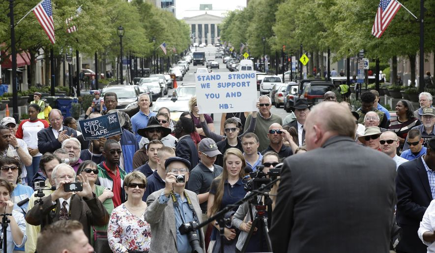 Supporters of House Bill 2 gather outside the North Carolina State Capitol in Raleigh, N.C., Monday, April 11, 2016, during a rally in support of a law that blocks rules allowing transgender people to use the bathroom aligned with their gender identity. (AP Photo/Gerry Broome)