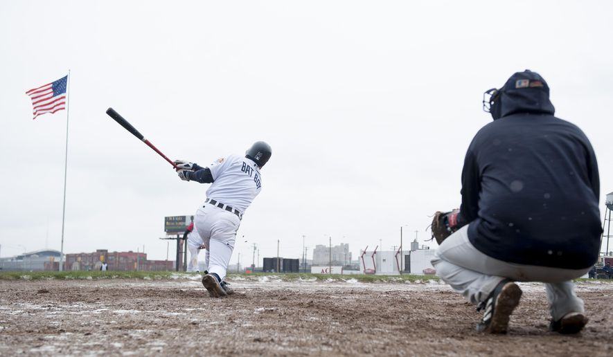 Eric Toysa, who was a bat boy at the old Tiger Stadium during its last season, hits the ball while warming up before a game on the site of the old stadium in Detroit, Sunday, April 10, 2016. Volunteers and baseball fans gathered over the weekend at the site of the old Tiger Stadium for a farewell of sorts to the former ballpark's field. (David Guralnick/Detroit News via AP)  DETROIT FREE PRESS OUT; HUFFINGTON POST OUT; MANDATORY CREDIT