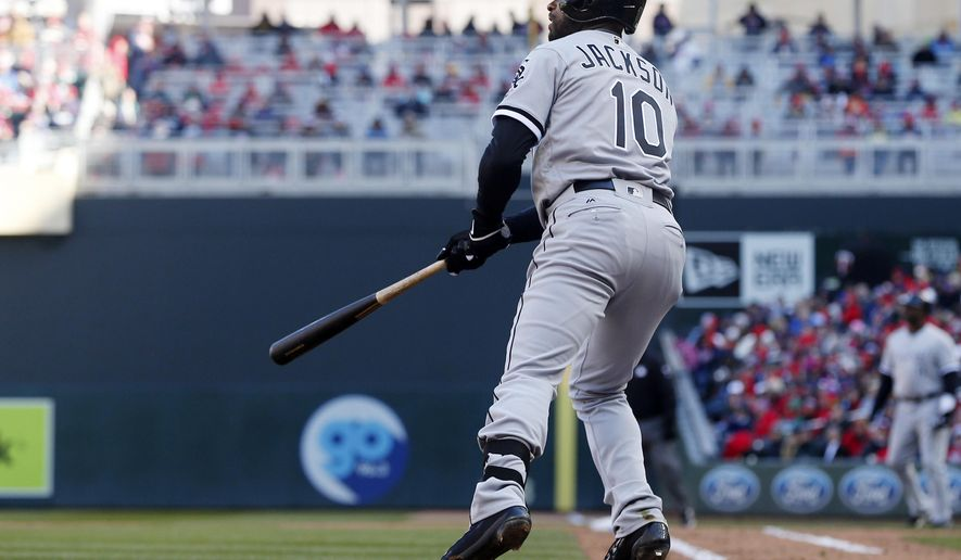 Chicago White Sox' Austin Jackson watches his two-run single off Minnesota Twins pitcher Kyle Gibson in the fourth inning of a baseball game Monday, April 11, 2016, in Minneapolis. (AP Photo/Jim Mone)