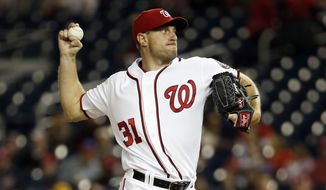Washington Nationals starting pitcher Max Scherzer throws during the third inning of a baseball game against the Atlanta Braves at Nationals Park, Monday, April 11, 2016, in Washington. (AP Photo/Alex Brandon)