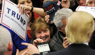 Supporters for Presidential candidate Donald J. Trump wait for autographs following a rally at Griffiss International Airport, Tuesday, April 12, 2016 in Rome, N.Y. (Mark DiOrio/Observer-Dispatch via AP)